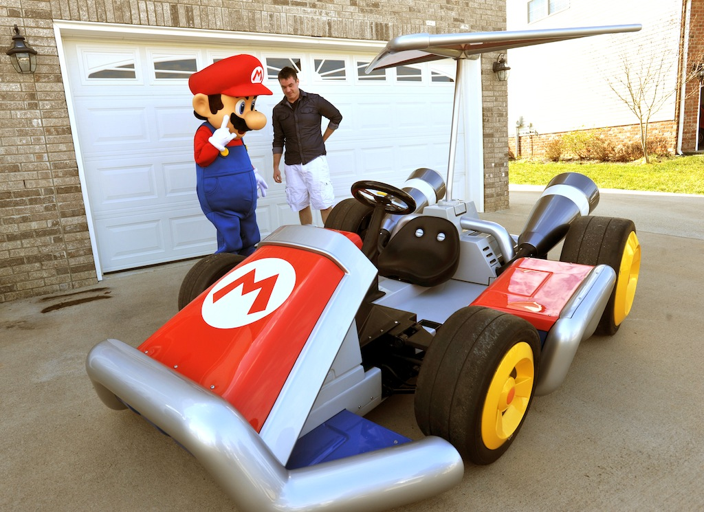 In this photo provided by Nintendo of America, Mario delivers a life-size Mario Kart vehicle to Nathanial Stehley, 27, the lucky winner of GameStop's Epic Reward Giveaway, on Feb. 28, 2012, in Clarksville, Tenn. Nintendo teamed with West Coast Customs to create drivable versions of two karts found in Mario Kart 7 for the portable Nintendo 3DS system in celebration of the recent launch of the game. (Christopher Berkey/AP Images for Nintendo of America).