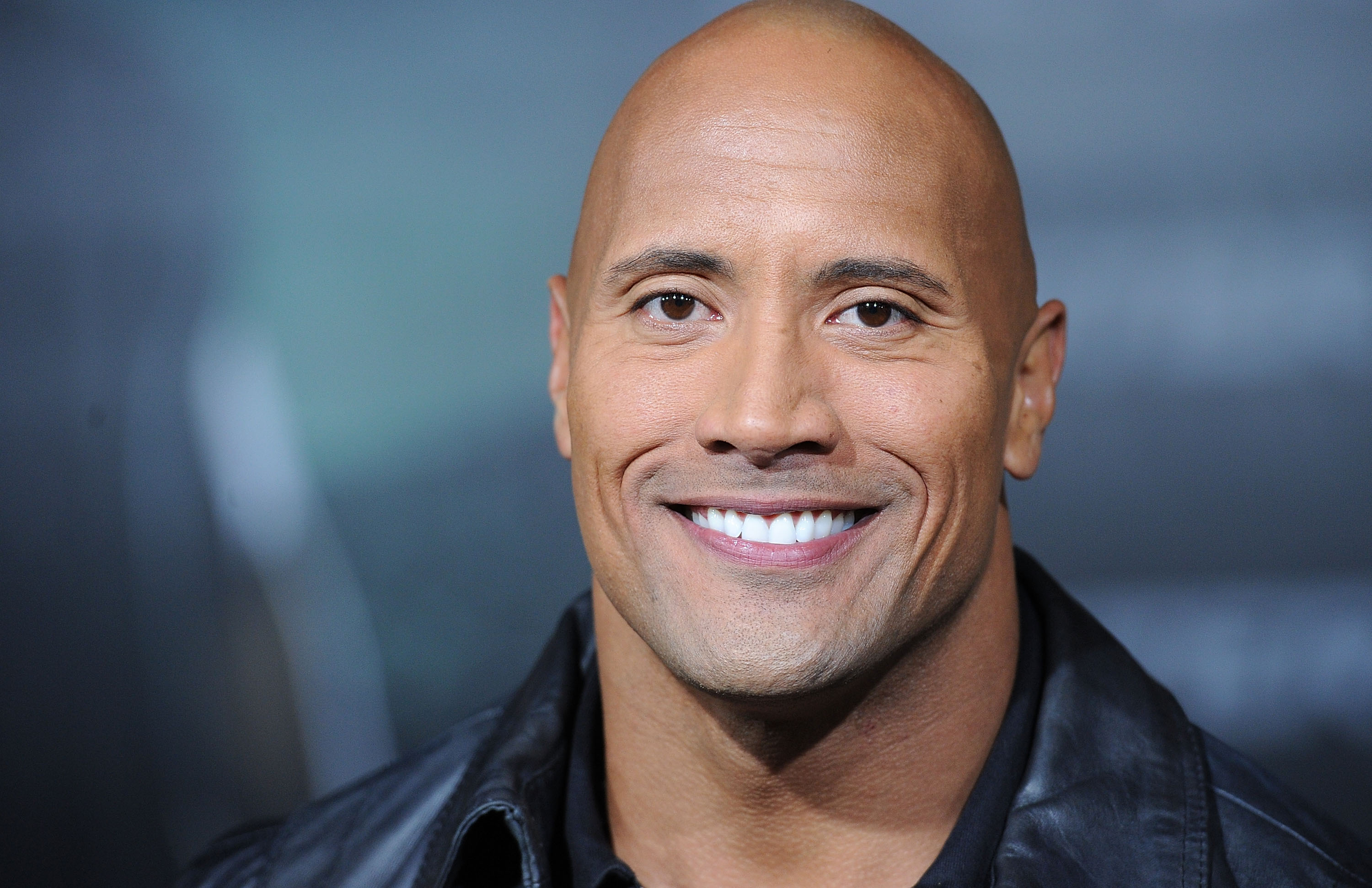 """HOLLYWOOD - NOVEMBER 22: Actor Dwayne Johnson arrives at the """"Faster"""" Los Angeles Premiere at Grauman's Chinese Theatre on November 22, 2010 in Hollywood, California. (Photo by Jason Merritt/Getty Images)"""